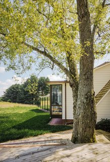 A pre-existing deck off the living room was built around a 70-year-old silver maple tree.