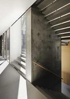 The walls of the staircase are made of poured-in-place smooth concrete.