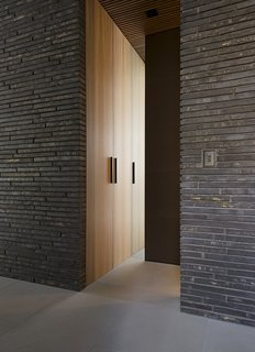 The handmade bricks found throughout the exterior and interior of the house are by Danish company Petersen Tegl.