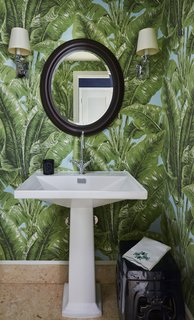 """That wallpaper [in the guest bath] is called Beverly Hills,"" says Johnson, ""and I'd always wanted that. I'd always wanted a variation of that print."""