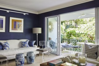 Wong and Johnson feel their Palm Beach apartment is a reflection of both their personalities. The couple love the navy blue of color of the living room and say it relaxes them.
