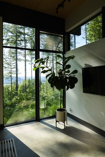 More floor-to-ceiling windows usher the lush landscape inside.