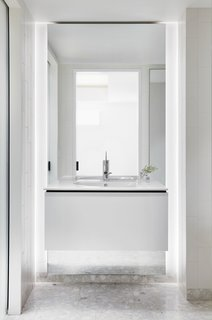 In the bathroom, the vanity and sink are by Duravit.