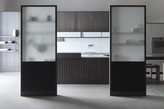 The Henrybuilt Functional Partition Wall provides elegant spatial screening or division of space within the kitchen. It provides both privacy and transparency, creating distinct spaces without dividing them harshly.