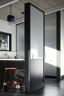 One side of the Functional Partition Wall is sculptural, meant to beautifully separate the kitchen space.