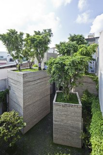 A Concrete Home in Vietnam Is Topped With Trees - Photo 15 of 20 -