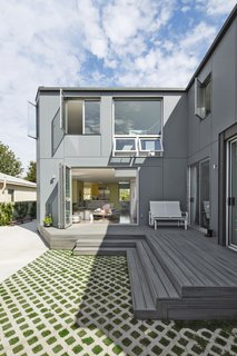 """For his own home in Mar Vista, designer Mohamed Sharif retained the front portion of a 1940s bungalow and added an L-shaped, two-story volume at the rear that includes a wing for his mother-in-law. """"Adapting and reusing and being sensitive to the neighborhood context was important,"""" he says. The structure is sheathed in fiber cement HardiePanels. The decking is by Trex."""