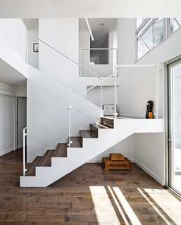 The rear of the house was expanded to include a family room and an open stairwell that leads to the kids' bedrooms.