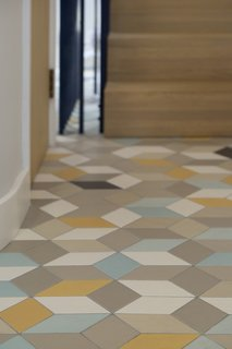 The hallway tiles are by Domus.