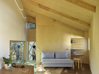 The interior of the tree house is made up of a set of informal spaces, including a loft on the top floor.