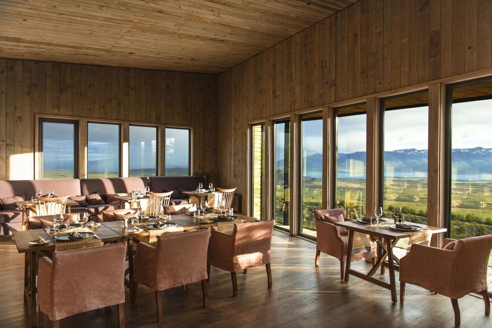 Dining Room, Medium Hardwood Floor, Table, Bench, and Chair  Awasi Patagonia