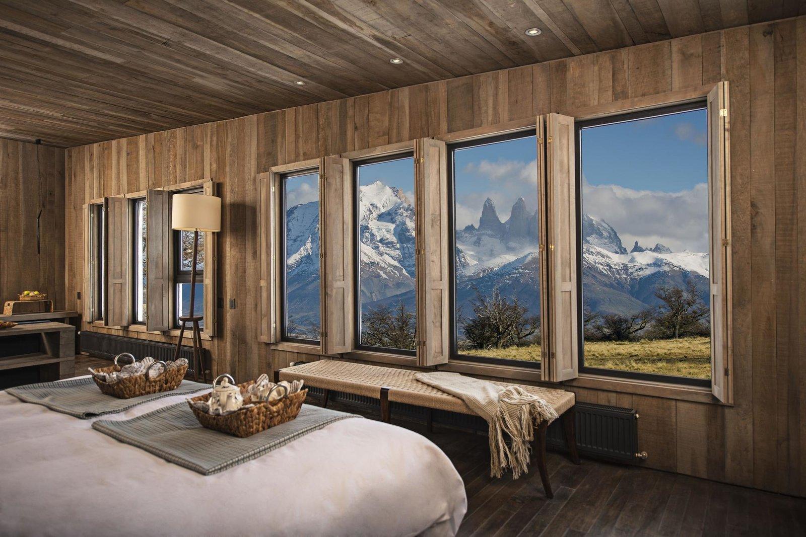Bedroom, Bed, Bench, Recessed Lighting, Floor Lighting, and Dark Hardwood Floor  Awasi Patagonia