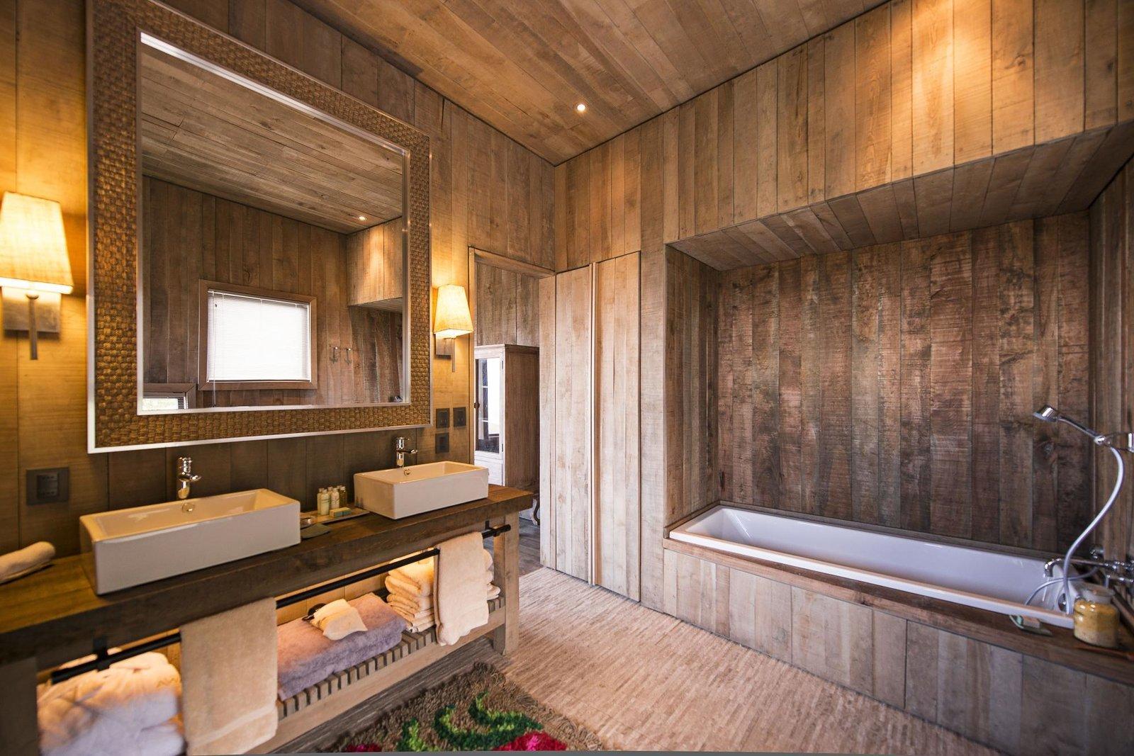 Bath Room, Vessel Sink, Alcove Tub, Wall Lighting, Recessed Lighting, and Wood Counter  Awasi Patagonia