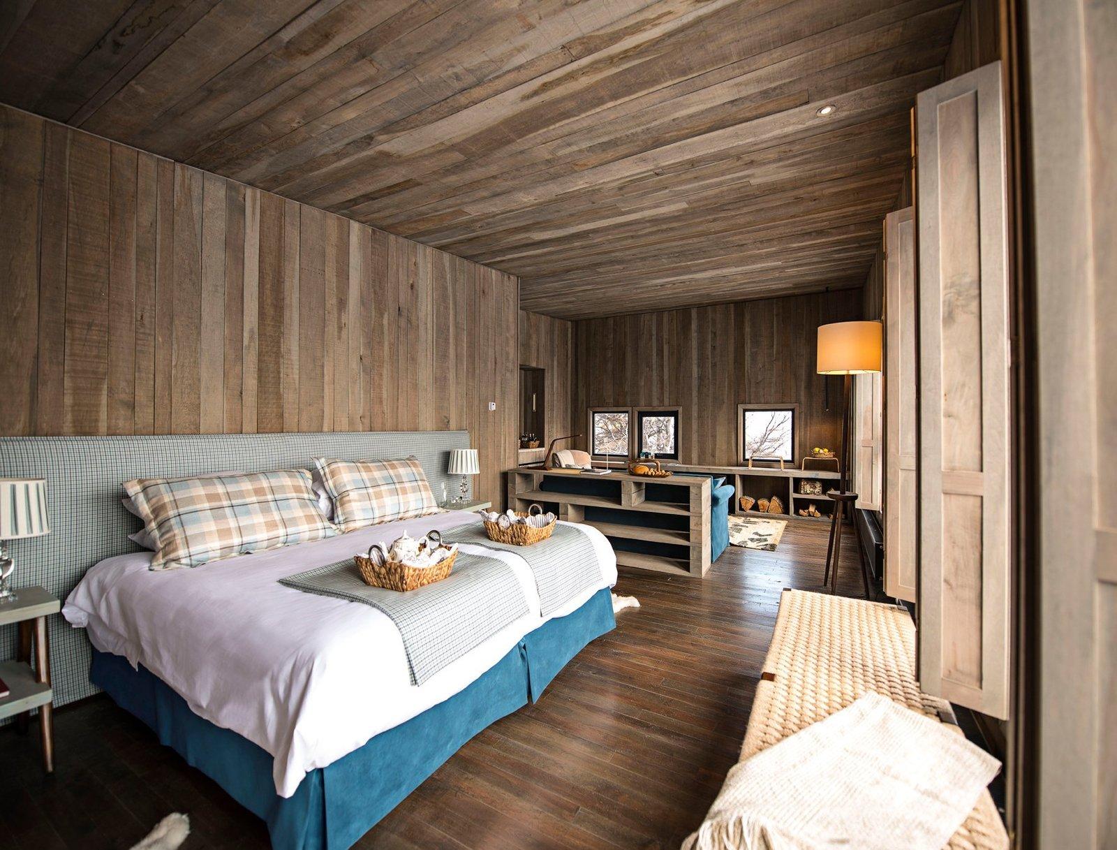 Bedroom, Bed, Floor Lighting, Table Lighting, Night Stands, Dark Hardwood Floor, and Bench  Awasi Patagonia
