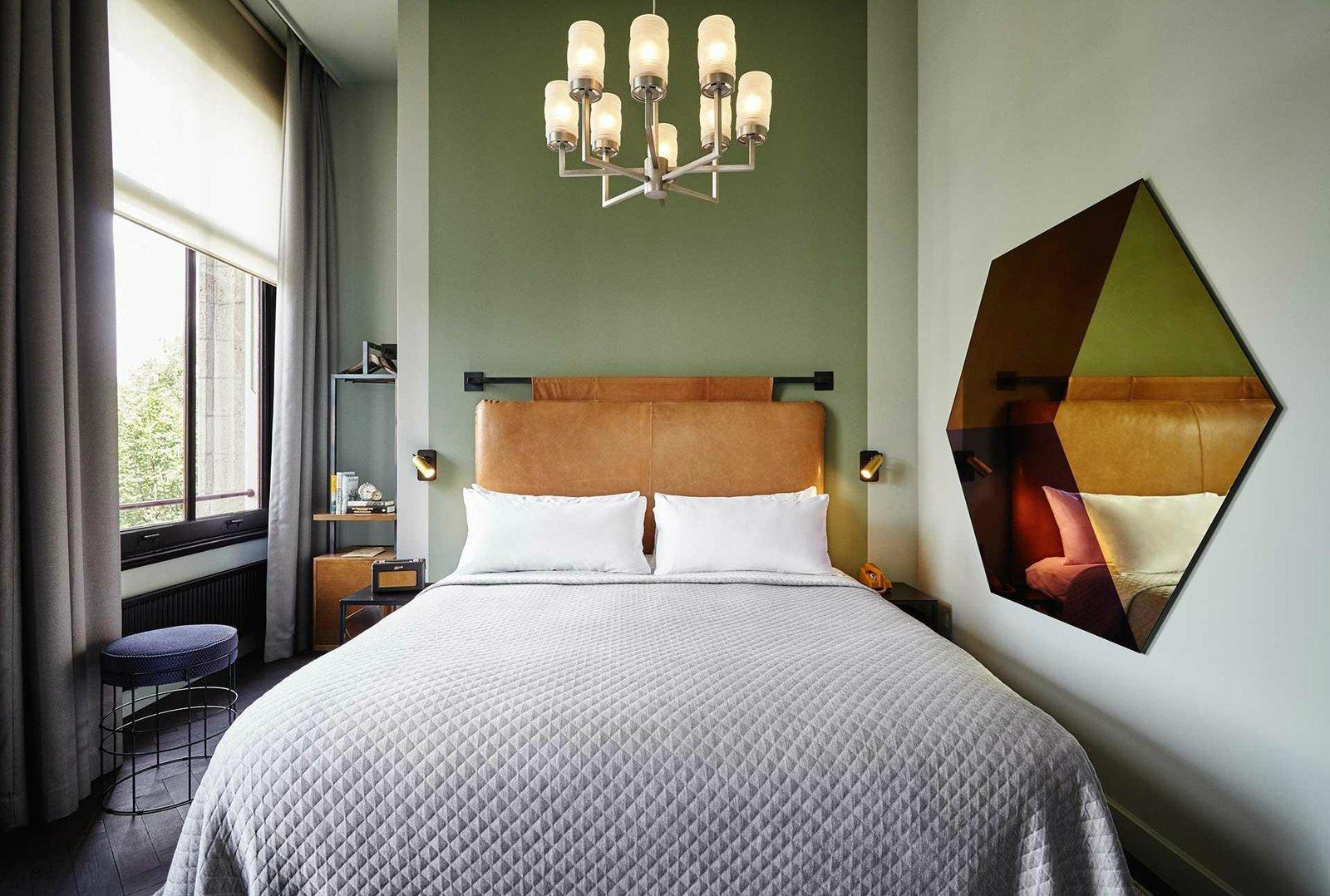 Bedroom, Night Stands, Dark Hardwood Floor, Wall Lighting, Pendant Lighting, and Bed  The Hoxton Amsterdam