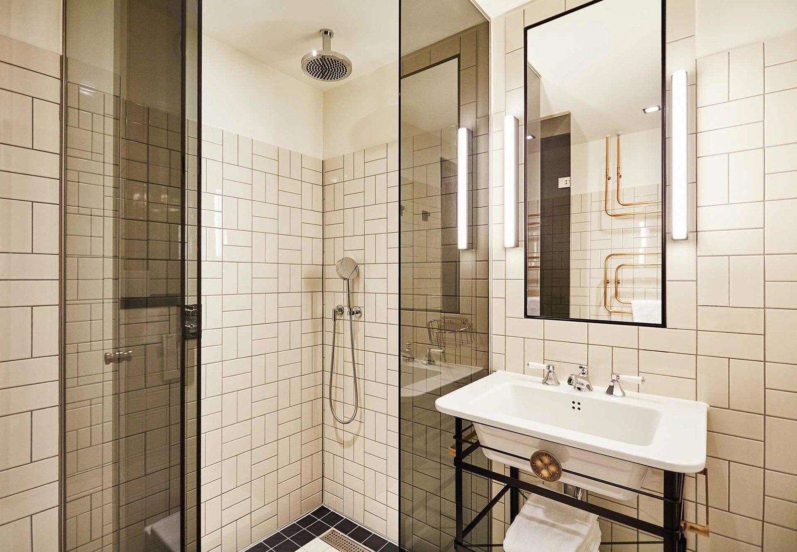 Bath Room, Corner Shower, Pedestal Sink, and Wall Lighting  The Hoxton Amsterdam