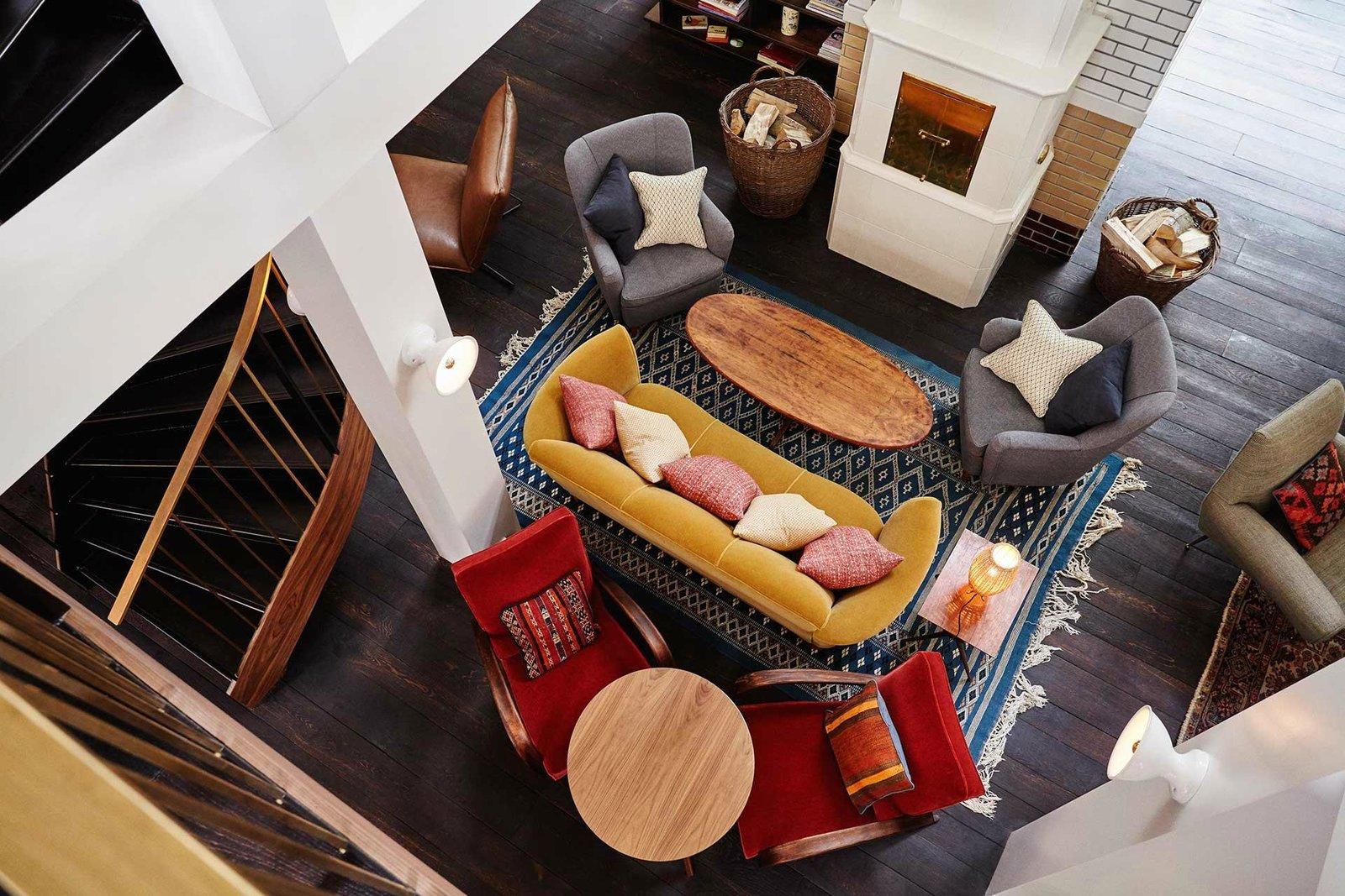 Living Room, Table Lighting, Wall Lighting, Sofa, Chair, End Tables, Rug Floor, Dark Hardwood Floor, and Coffee Tables  The Hoxton Amsterdam