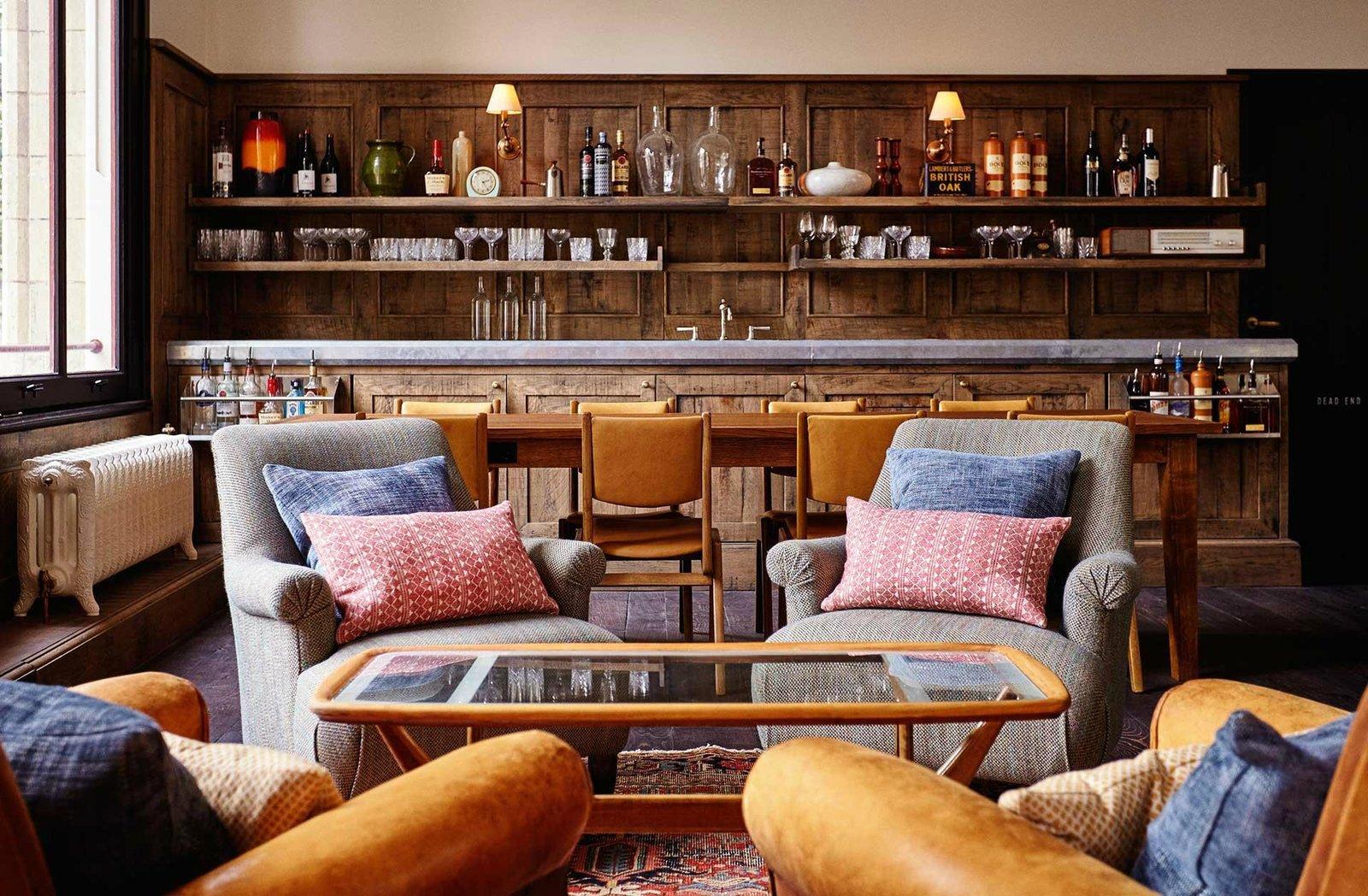 Living Room, Rug Floor, Wall Lighting, Bar, Chair, Dark Hardwood Floor, Table, and Coffee Tables  The Hoxton Amsterdam