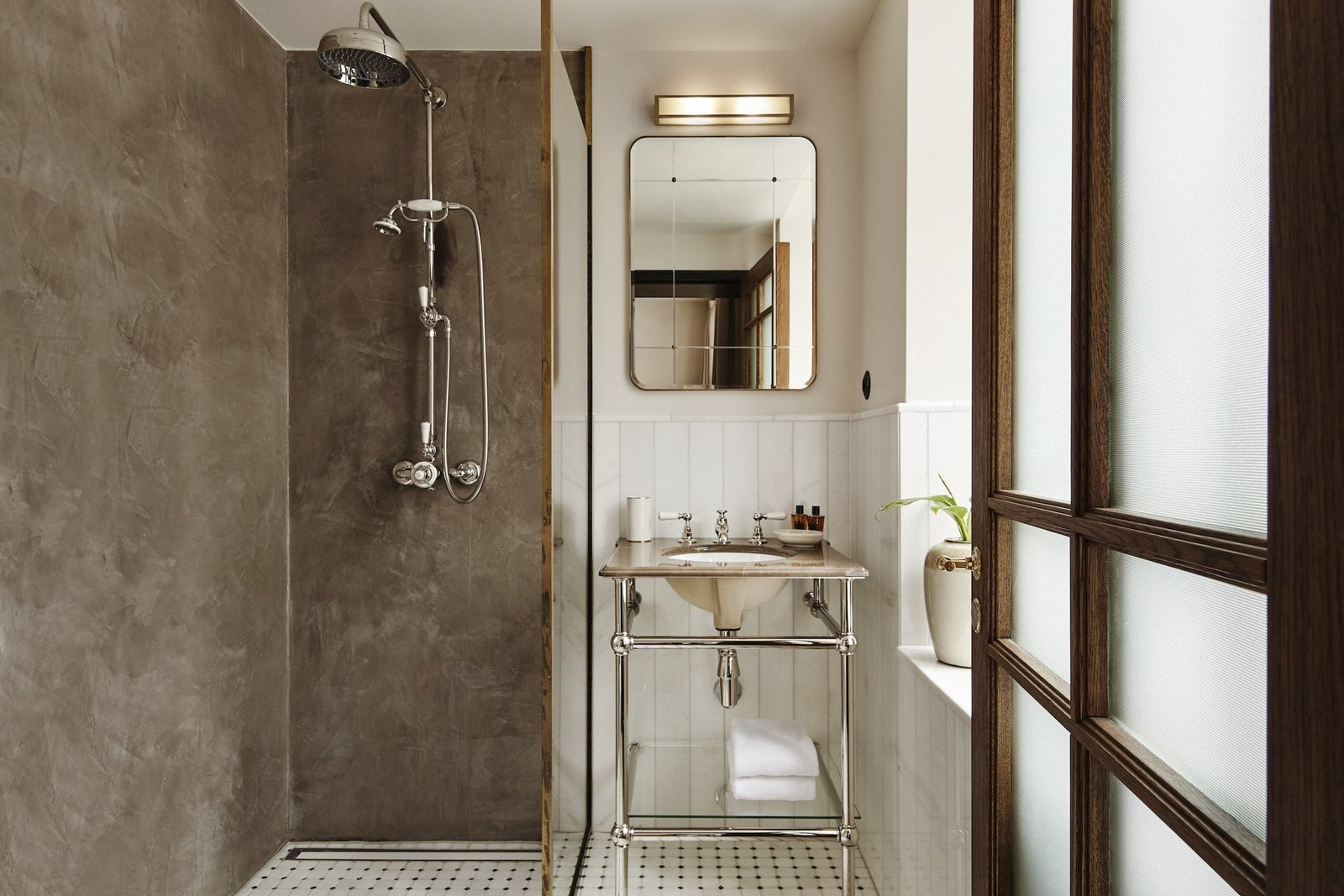 Bath Room, Undermount Sink, Pedestal Sink, Open Shower, and Wall Lighting  Hotel Sanders