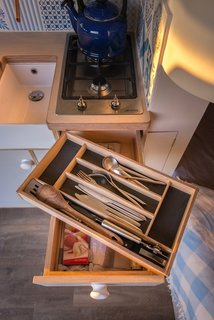"""""""The details, such as the fine joinery and fancy bits, took a while longer to get right,"""" says Richens, who custom-built every detail down to the silverware boxes. """"The custom cutlery tray inserts were made to measure to fit the drawers. It was a bit of a flight of fancy, but once you're down the rabbit hole, you may as well keep going."""""""