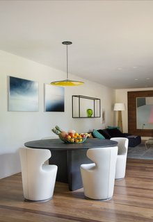 In a separate wing, the residents enjoy a private TV room and dining area.