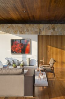 Interior designer Tici Andriani sourced furnishings from Casual Móveis. Galeria Eduardo Fernandes curated the home's extensive artwork.