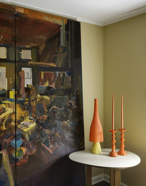 A painting by artist Erin Koch stands in the guestroom; the candlesticks were a garage sale find.