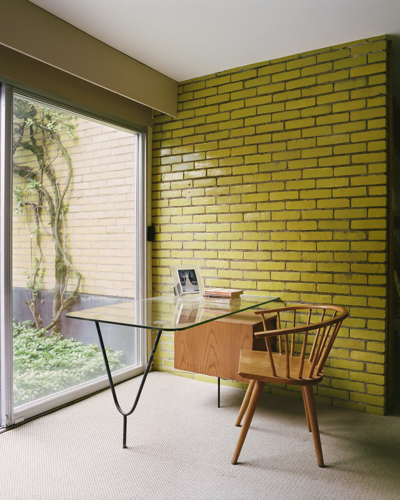 Office, Chair, Study, Desk, and Carpet  Dwell's Favorite Office Photos from This Michigan Couple Found Out They Own the Last Standing Home by Alexander Girard