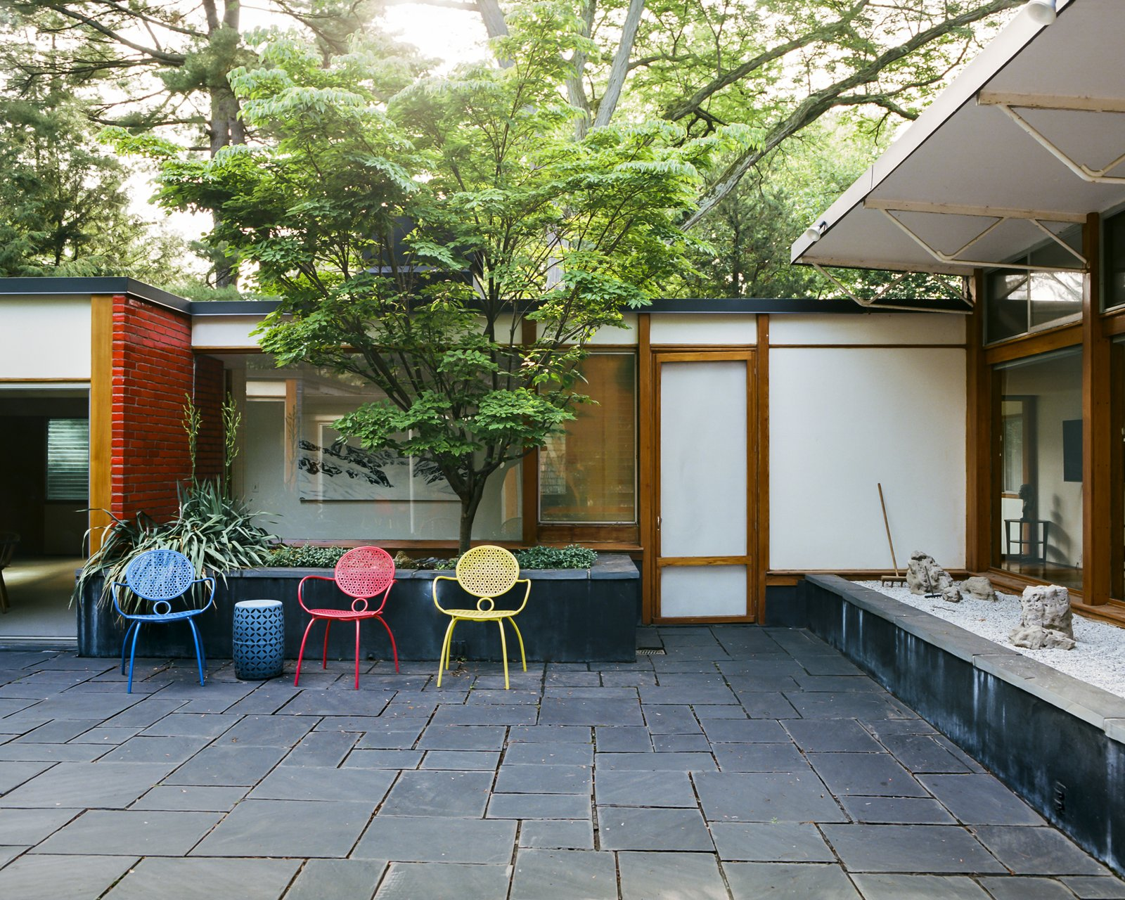 Outdoor, Stone, Garden, Trees, and Small  Best Outdoor Stone Garden Photos from This Michigan Couple Found Out They Own the Last Standing Home by Alexander Girard