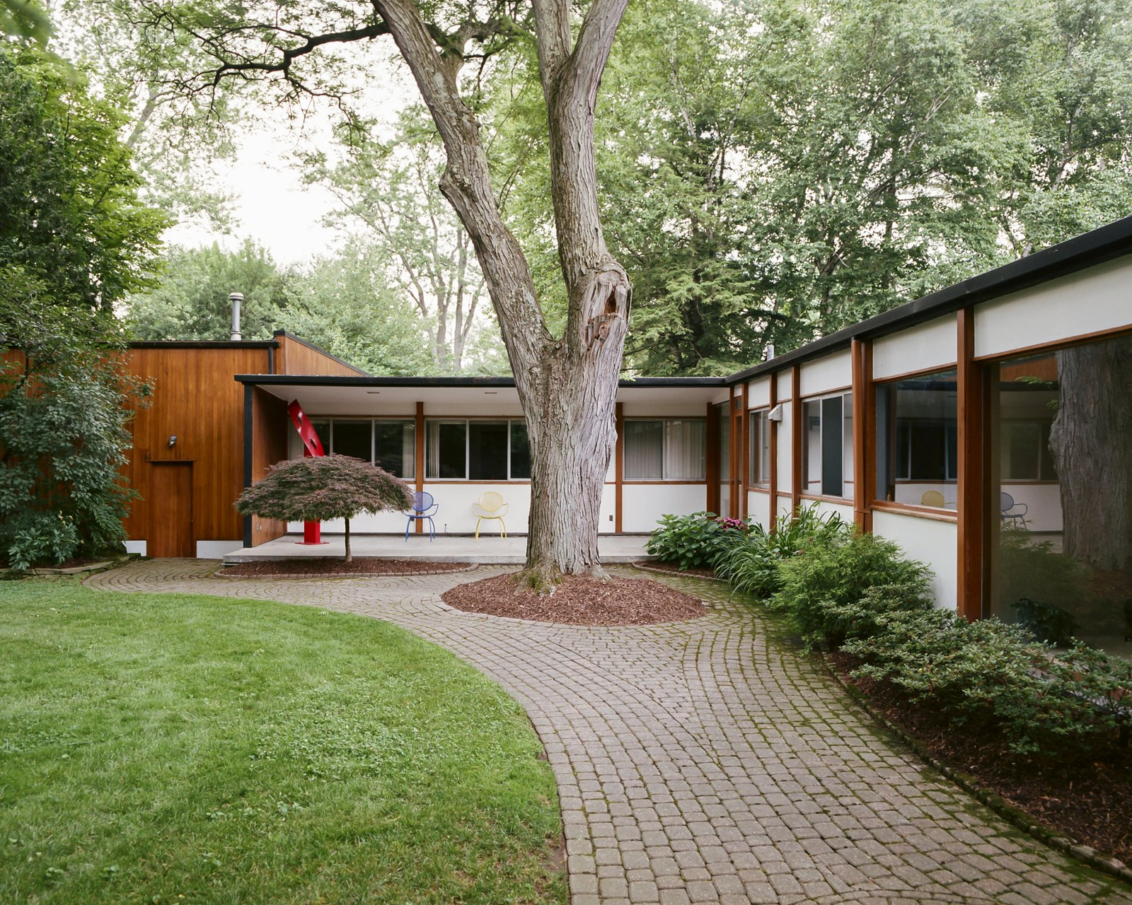 Exterior, House Building Type, Wood Siding Material, Flat RoofLine, and Mid-Century Building Type  Photos from This Michigan Couple Found Out They Own the Last Standing Home by Alexander Girard