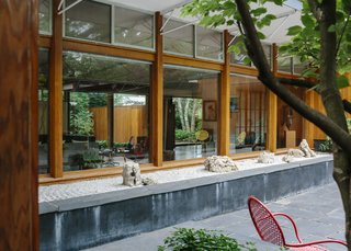 The Alexander Girard house centers on a courtyard, complete with slate pavers, a dogwood tree, and rock gardens.