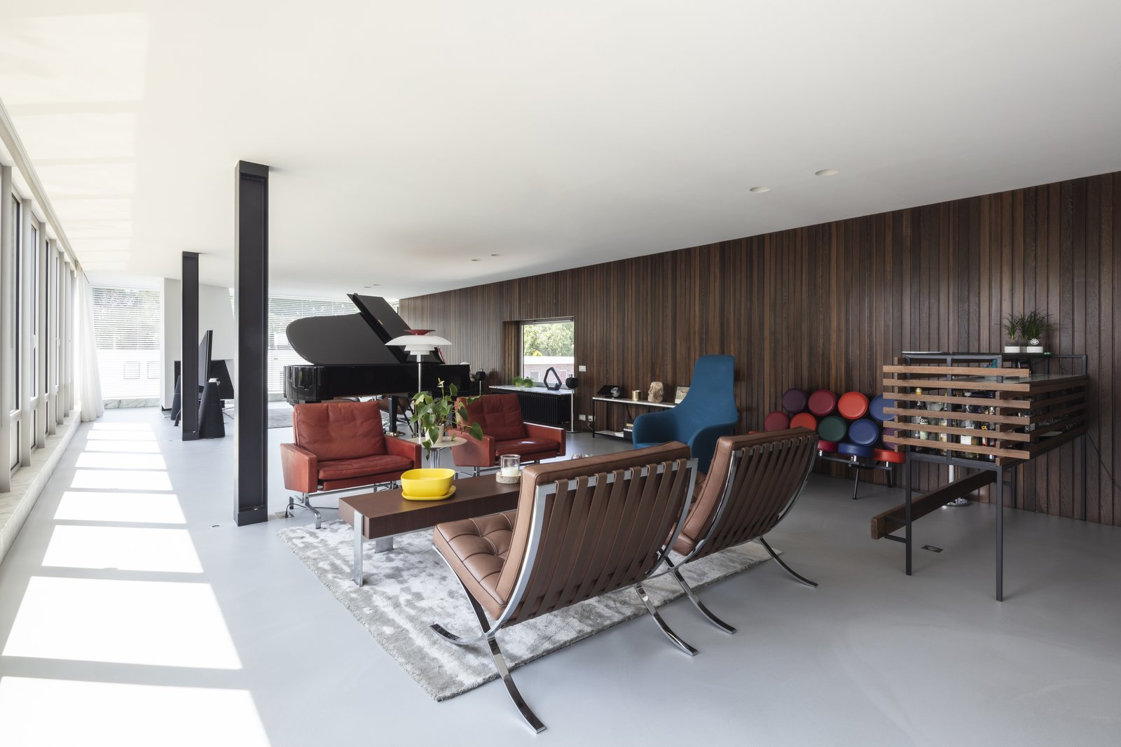 Living Room, Coffee Tables, Chair, Bench, Recessed Lighting, Floor Lighting, End Tables, and Rug Floor  Photos from A Major Restoration Updated This Midcentury Landmark in Belgium