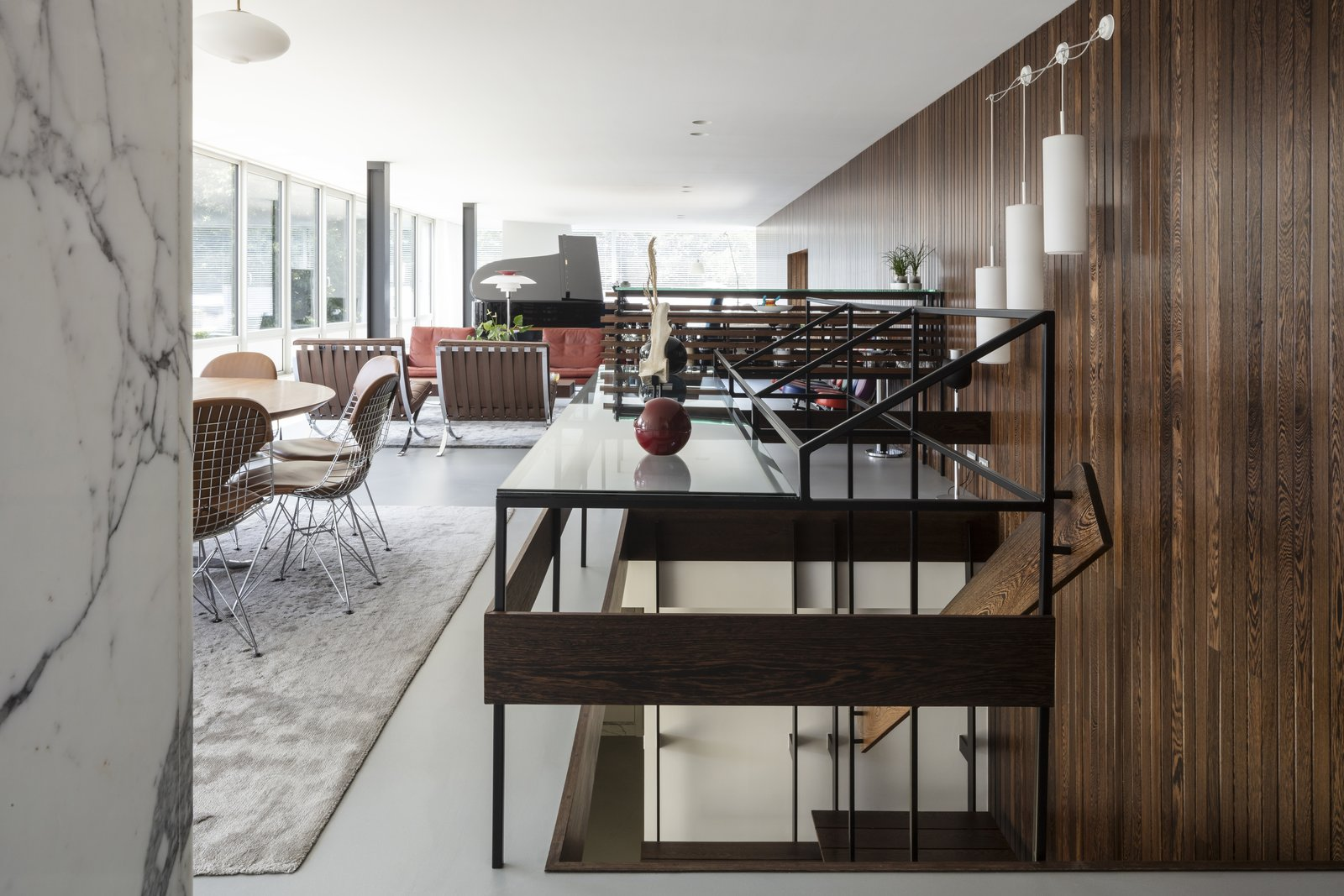 Dining, Table, Recessed, Pendant, Chair, Wall, and Rug  Best Dining Pendant Wall Photos from A Major Restoration Updated This Midcentury Landmark in Belgium