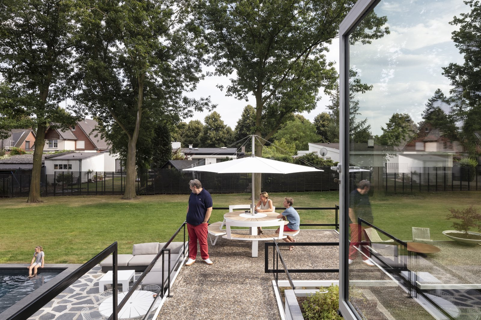 Outdoor, Grass, Swimming Pools, Tubs, Shower, Back Yard, Large Patio, Porch, Deck, Horizontal Fences, Wall, and Trees  Photos from A Major Restoration Updated This Midcentury Landmark in Belgium