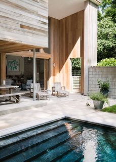 Wood, stone, and concrete create a sense of welcome and warmth.
