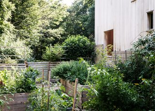 The kitchen leads directly to the lush garden.
