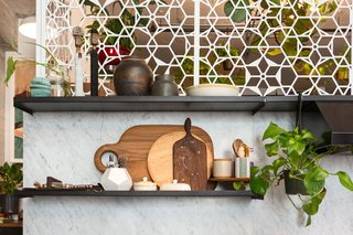 The graphic cutout screens that enclose Morrison's dressing room also back the kitchen. The screens were inspired by traditional Mexican ironwork.