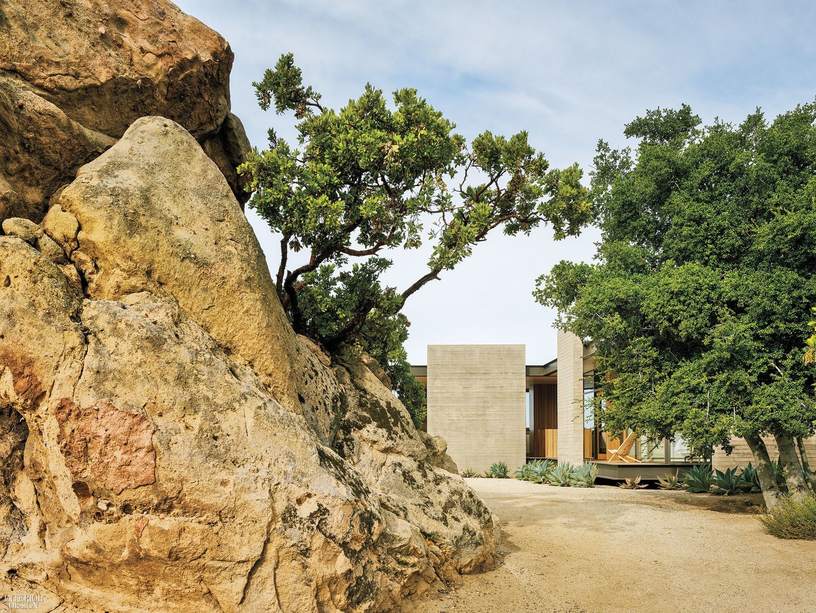 Outdoor, Trees, Side Yard, and Boulders  Best Photos from Take Your Next Vacation in a Midcentury Home in the Santa Monica Mountains
