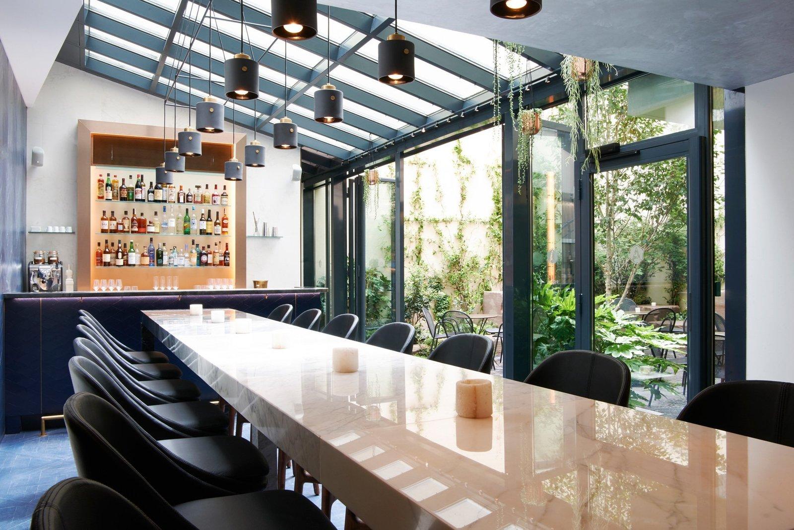 Dining Room, Table, Stools, Bar, and Pendant Lighting  Amastan Paris
