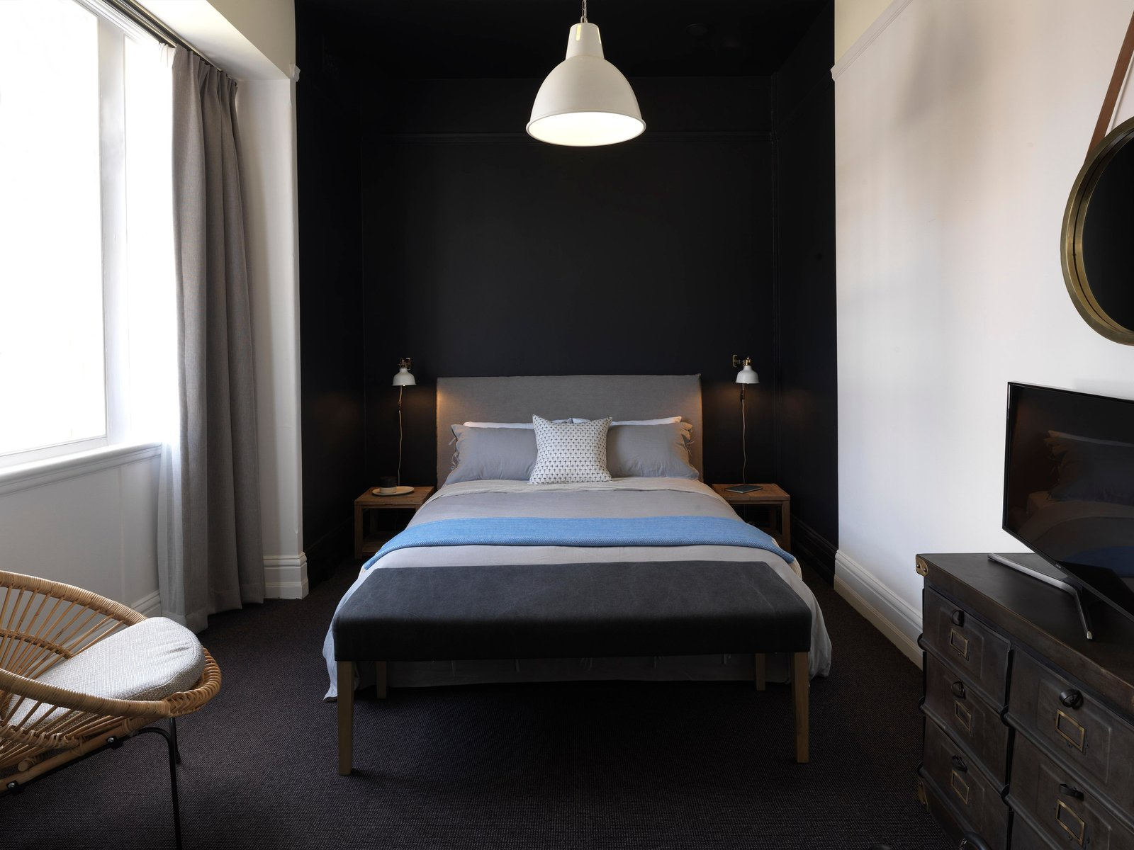 Bedroom, Bed, Chair, Carpet Floor, Wall Lighting, Pendant Lighting, and Night Stands  Hotel Palisade
