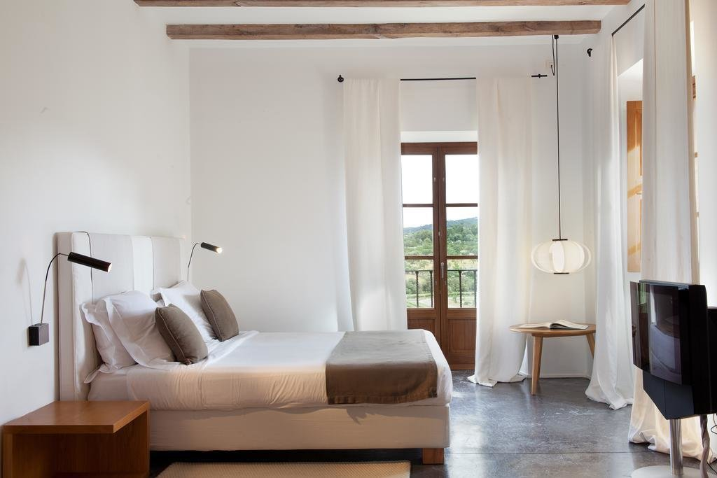 Bedroom, Pendant Lighting, Bed, Night Stands, and Wall Lighting  Son Brull Hotel & Spa
