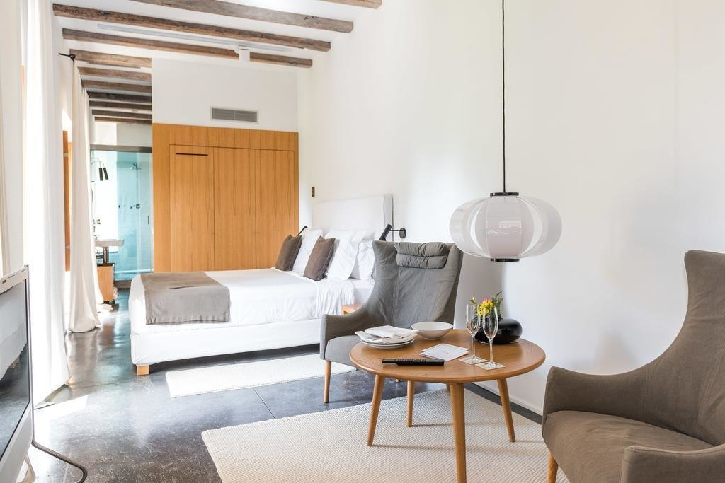 Bedroom, Rug Floor, Chair, Wall Lighting, Bed, and Pendant Lighting  Son Brull Hotel & Spa