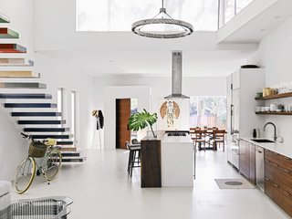 The walnut and Corian kitchen island anchors the first floor.