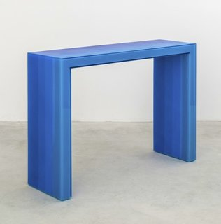 A blue gradient console from Facture Studio, made of layer of glossy resin.