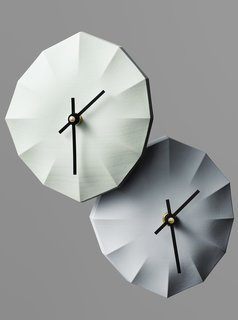 Designed by Ayako Aratani—one half of the practice Aratani Fay—the porcelain Click-Clock has no digits, only sculpted lines for reading the time.
