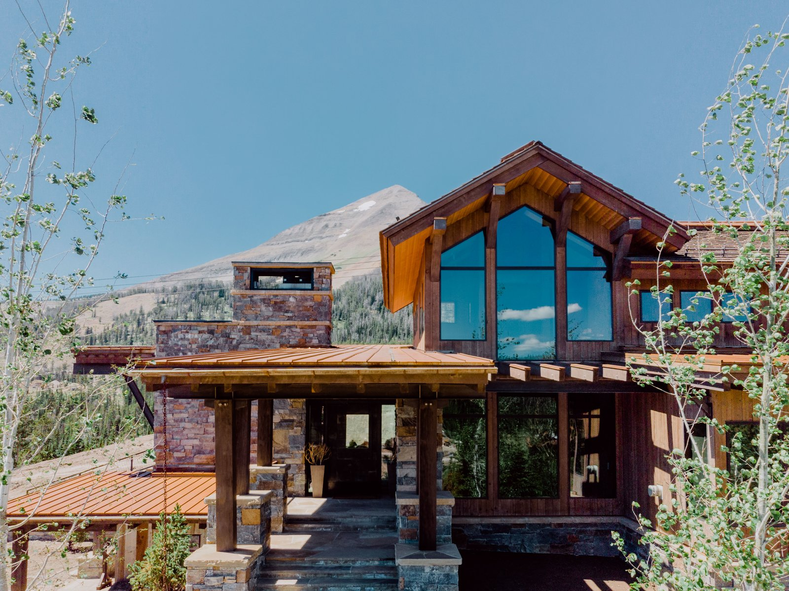 Exterior, House Building Type, Gable RoofLine, Stone Siding Material, and Wood Siding Material  Photo 1 of 12 in A Mountain Retreat in Montana Allows One Couple to Live in the View