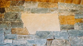 A Montana-shaped stone is just one of the textural details that ground the home in the rugged environment.
