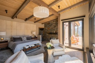 The master bedroom is a texturally rich space and offers views of Lone Peak.