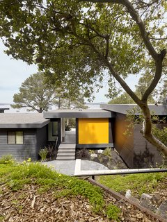 MDO panels the color of California poppies accent the home's exterior.
