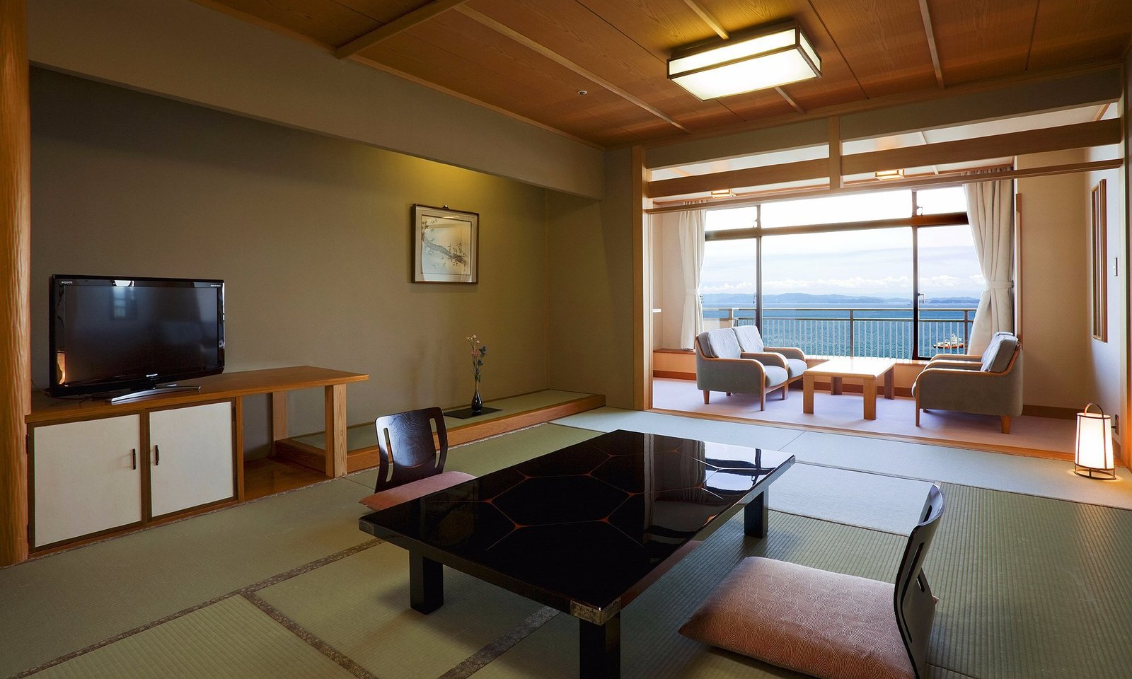Living Room, Chair, Coffee Tables, Table, and Ceiling Lighting  Villa Rakuen